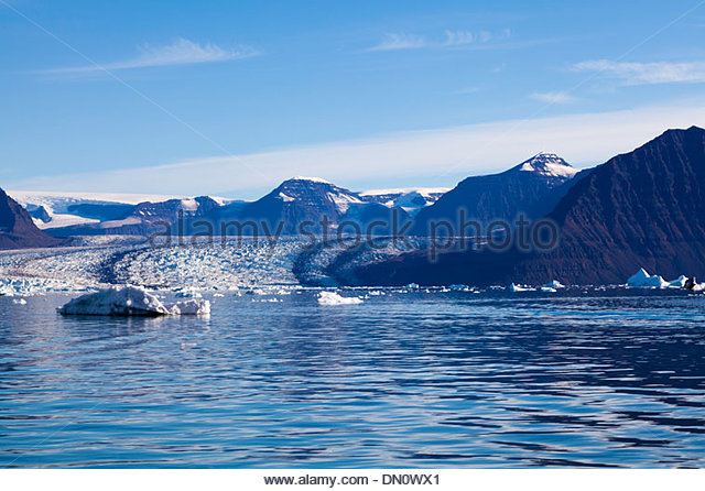Large glacier showing rock and stone debris, Fohnfjord, Greenland - Stock Image