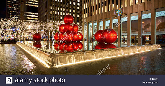 Giant red Christmas ornaments on 6th Avenue with holiday season decorations. Avenue of the Americas, Midtown Manhattan, - Stock Image