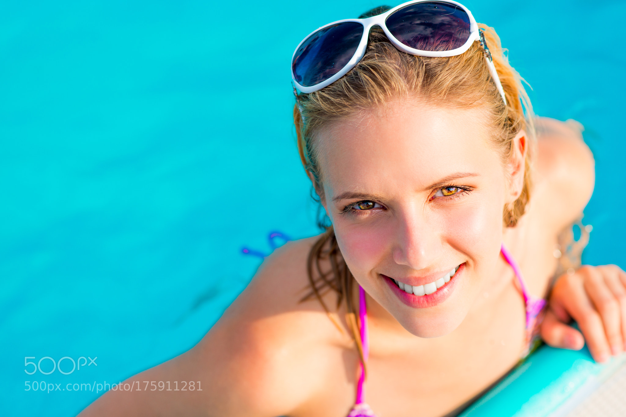 Beautiful young woman in the swimming pool