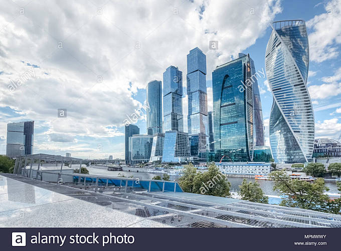 Summer cityscape with a view of Moscow's skyscrapers Moscow business center with modern buildings under a summer blue sky with cumulus white clouds - Stock Image