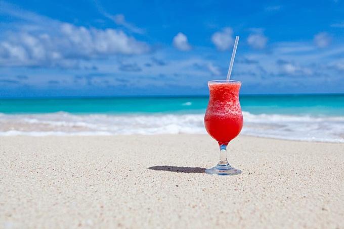 Red Slush Drink in Glass on Beach