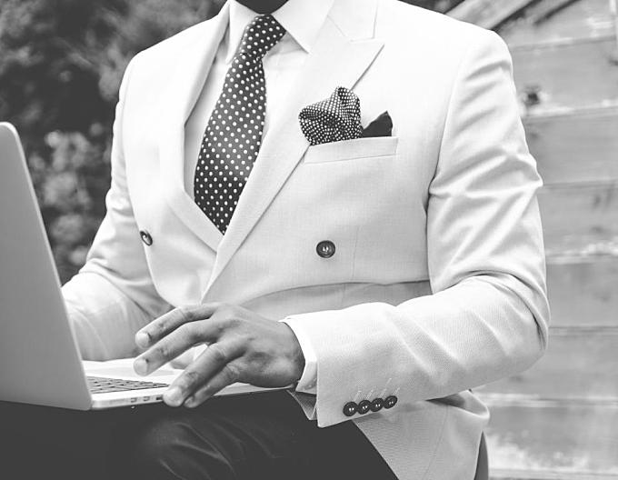 suit, blazer, tie, pocket square, fashion, guy, man, gentleman, laptop, computer, technology, working, business, creative, black and white, people, lifestyle