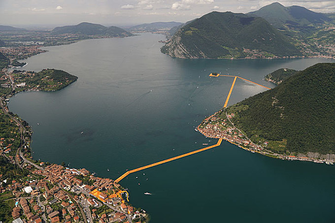 Christo builds vivid yellow ribbon bridge across Italian lake