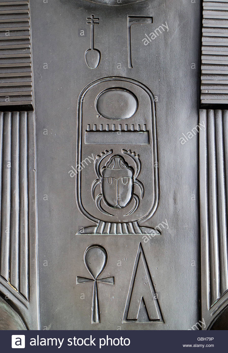 Hieroglyphs (with scarab and ankh) on one of the bronze sphinxes at the base of Cleopatra's Needle, Victoria - Stock Image