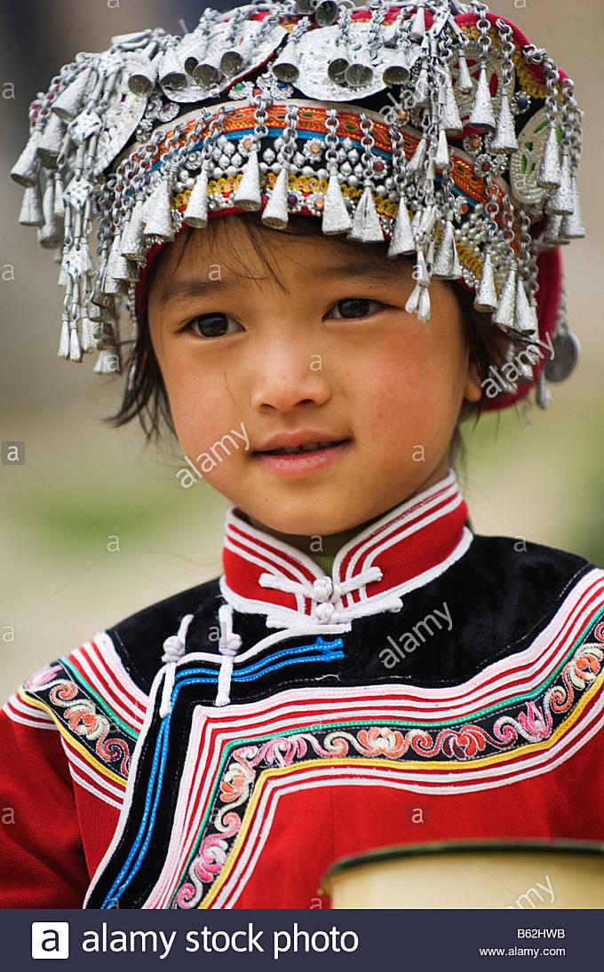 China Yunnan Yuanyang minority girl in costume - Stock Image