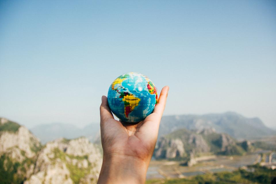 globe, global, map, round, colorful, outdoor, hand, palm, view, sky, mountain, highland, landscape, nature