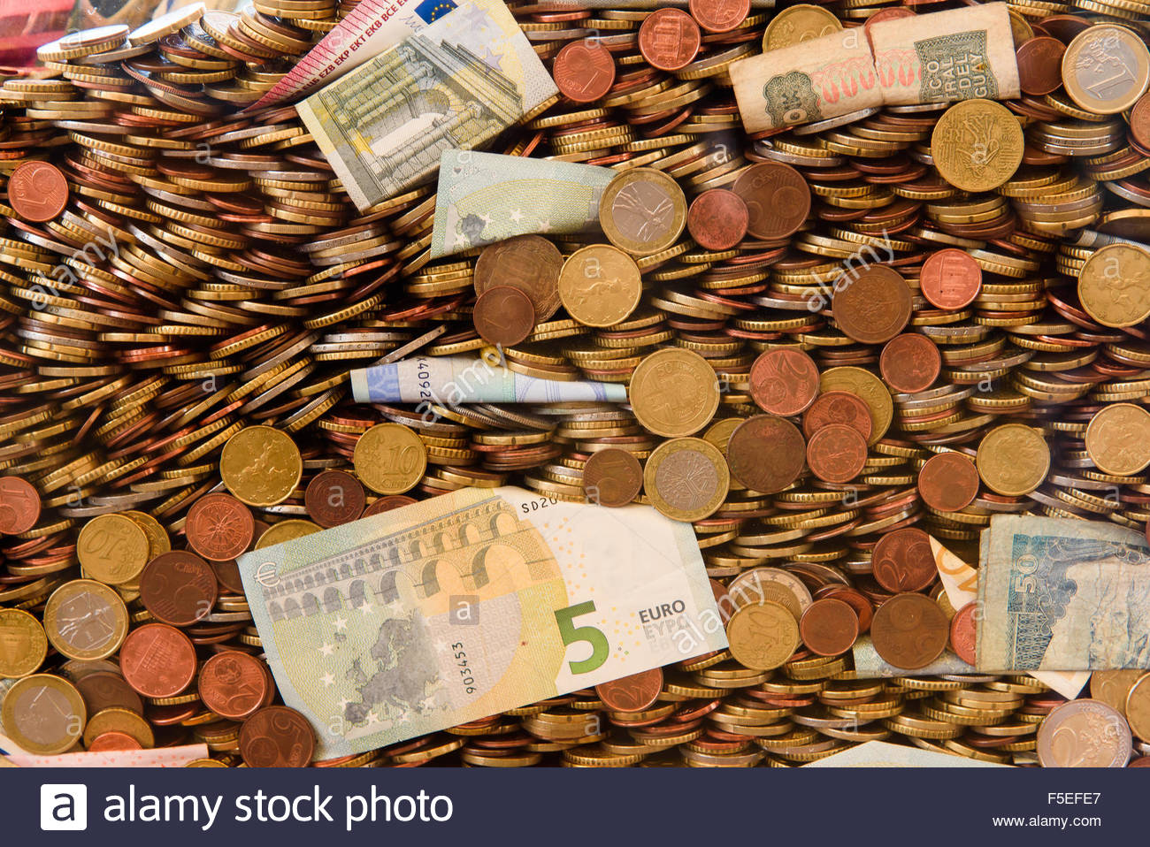Money background with bancknote and coins - Stock Image