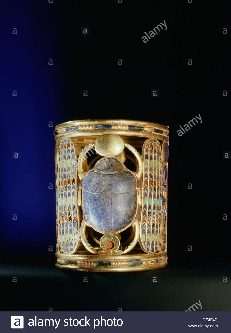 Gold bracelet from the tomb of Amenemope mounted with a lapis lazuli scarab bearing aloft the gold solar disc. - Stock Image