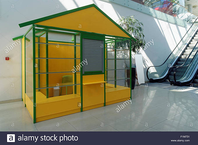 Standard mass production empty yellow booth  for any business stand in large shop - Stock Image