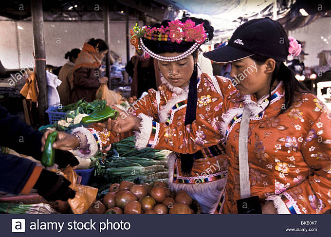 Mu Ze Latso a Mo Suo minority, with friend go shopping for groceries in Yongning town's market, Yunna Province, - Stock Image