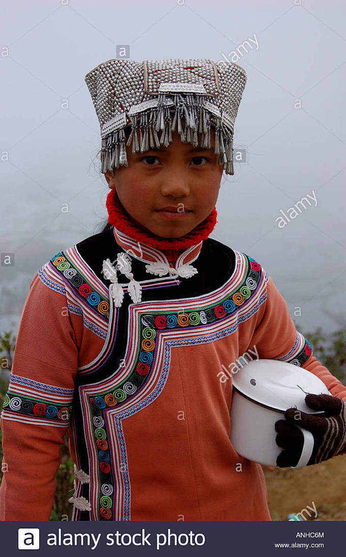 a girl have Yunnan Hani minority traditional clothes go to festival. - Stock Image