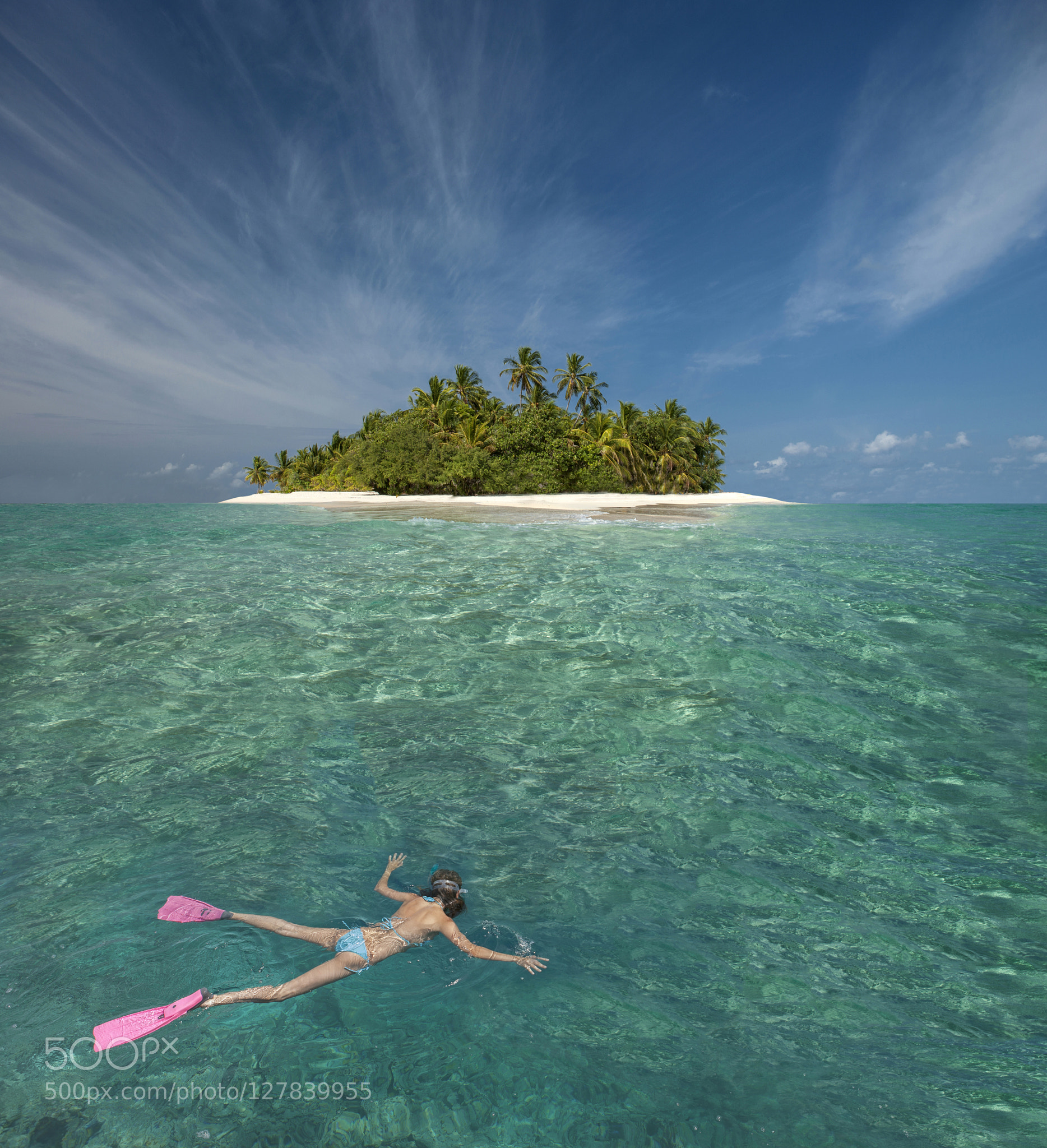 Caucasian woman snorkeling off tropical island